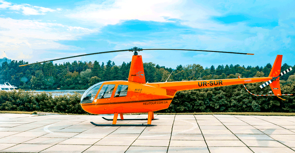 Нelicopter rental Robinson R44 orange